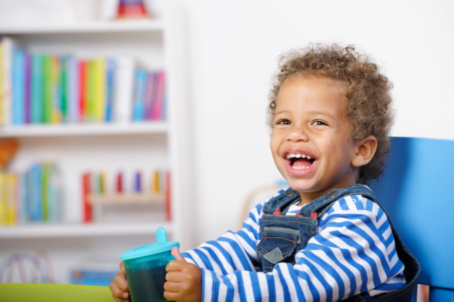 toddler happy with cup