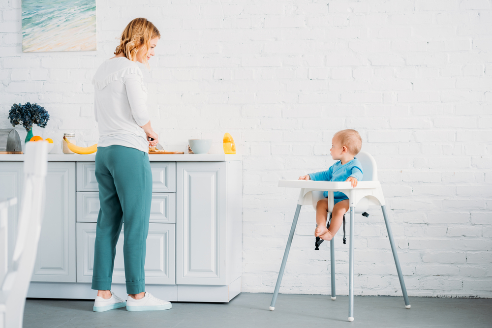 baby making dinner with mom
