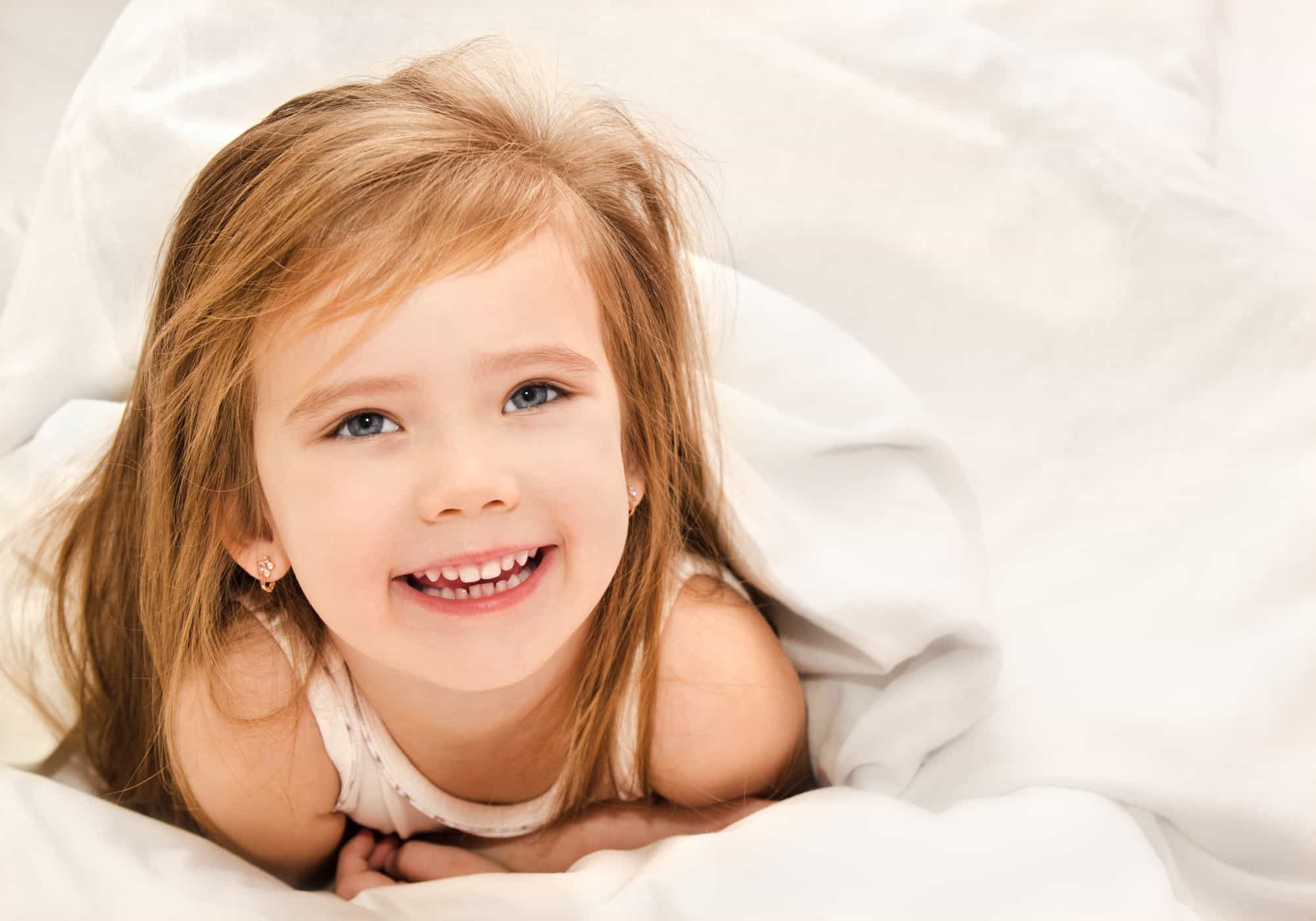 toddler happy in bed