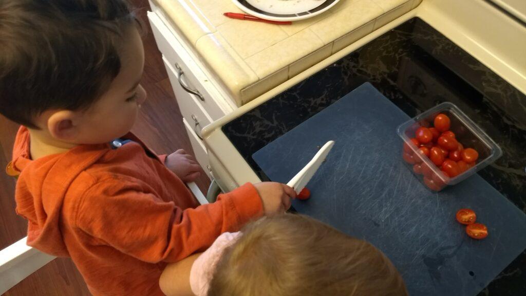 toddler using kid-safe knife