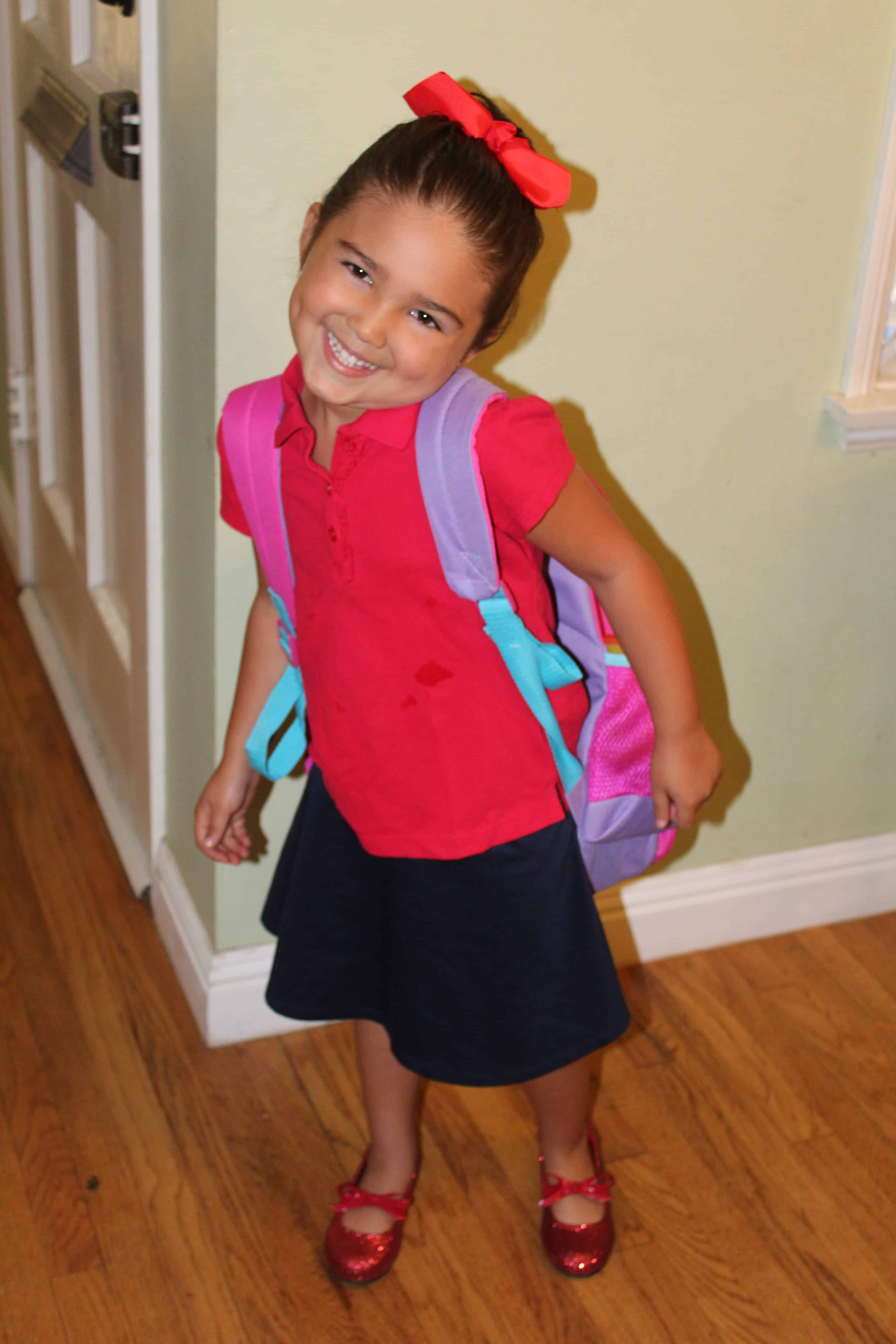 Smiling Child ready for school with their backpack!
