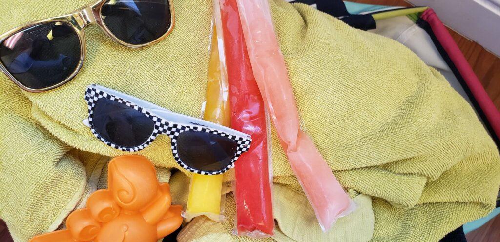 otter pops in a beach bag