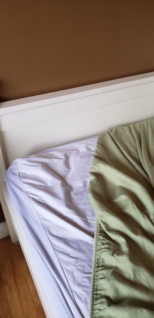 a bed with a mattress protector