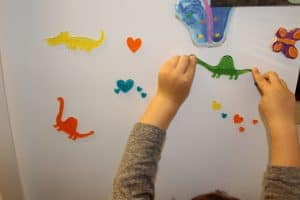 toddler playing with window clings- quiet activity for toddlers