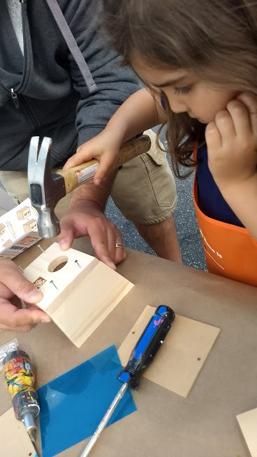 preschooler making a birdhouse at lowes