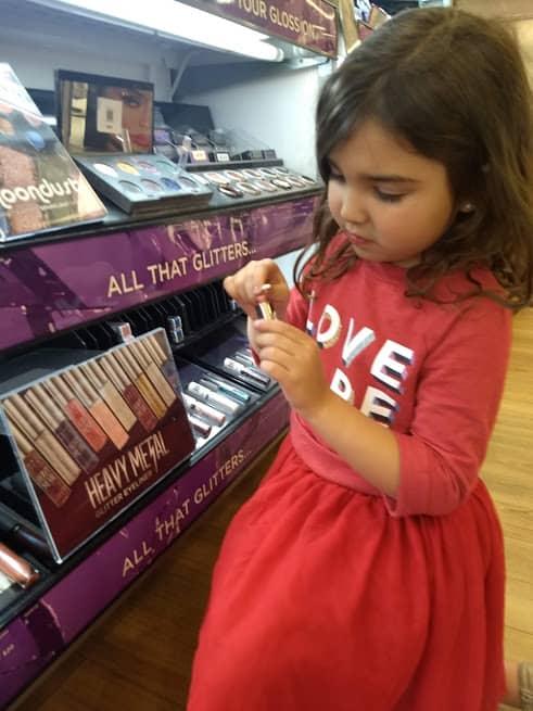 preschooler playing with makeup at ulta