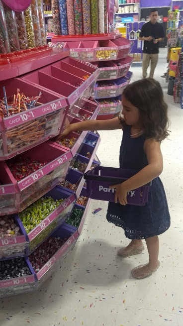daughter shopping for candy at party city