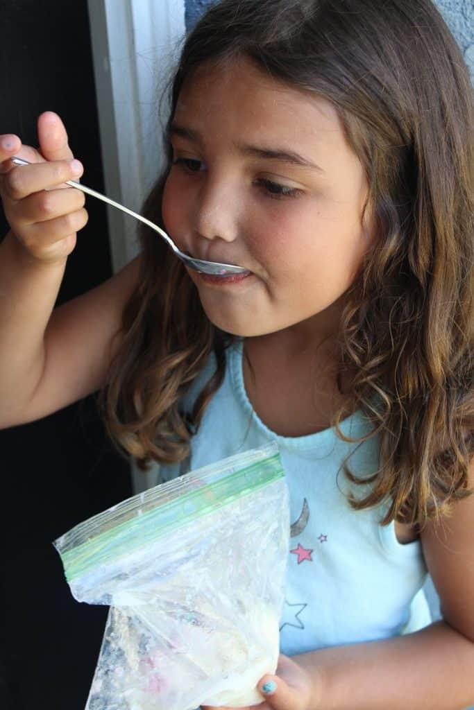 preschooler eating ice cream in a bag