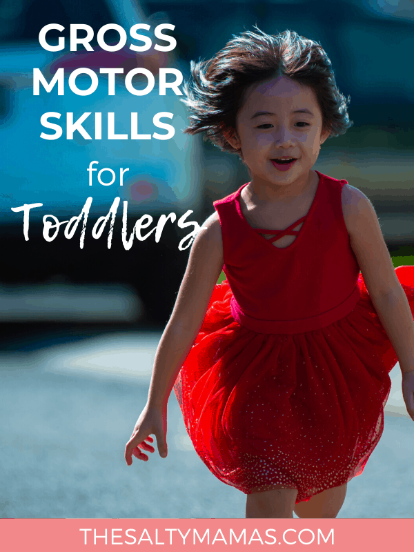 Toddler in a red dress blown by the wind; Text overlay: Gross motor skills for toddlers