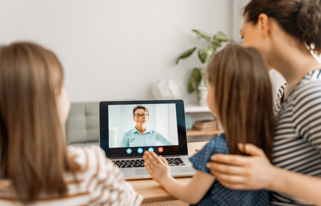 kids video chatting with their grandma