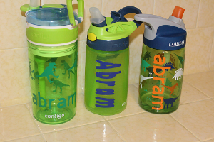 "water bottles labeled with the name ""abram"""