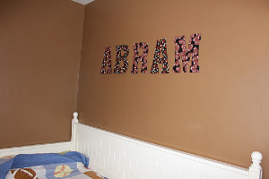 "letters on a wall spelling out the name ""abram"""