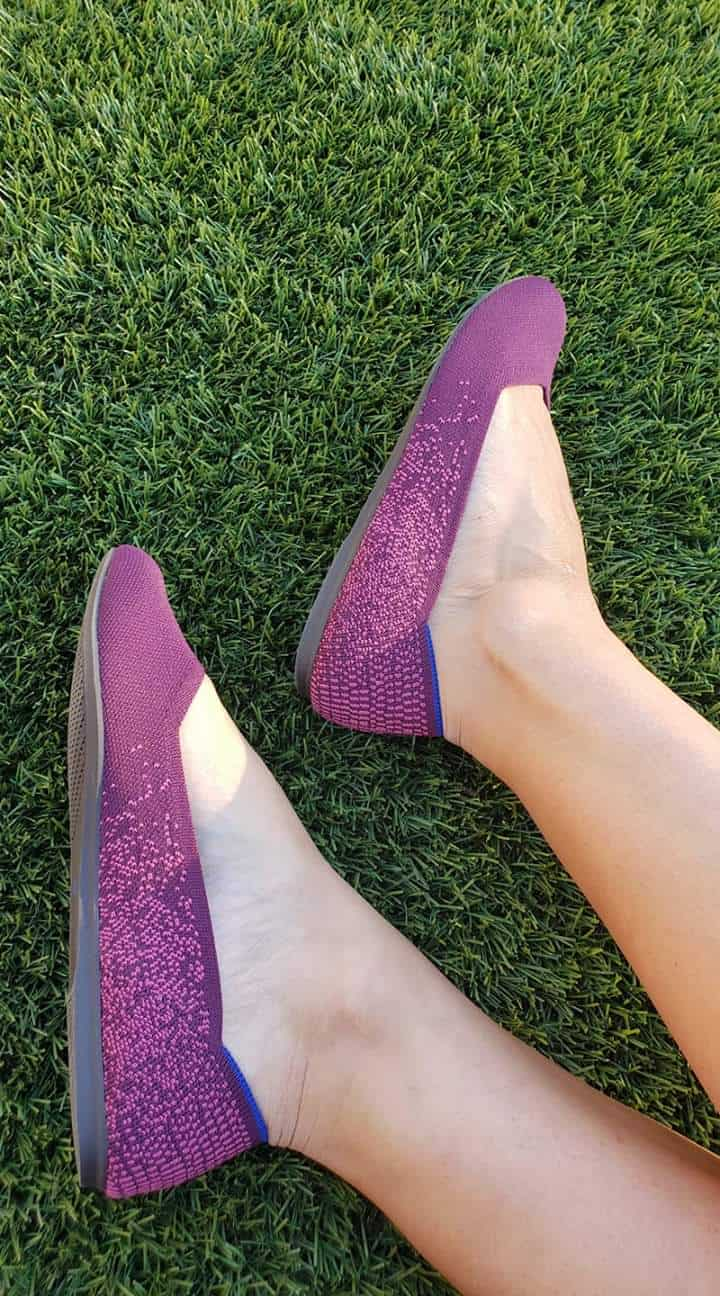 purple rothys on grass