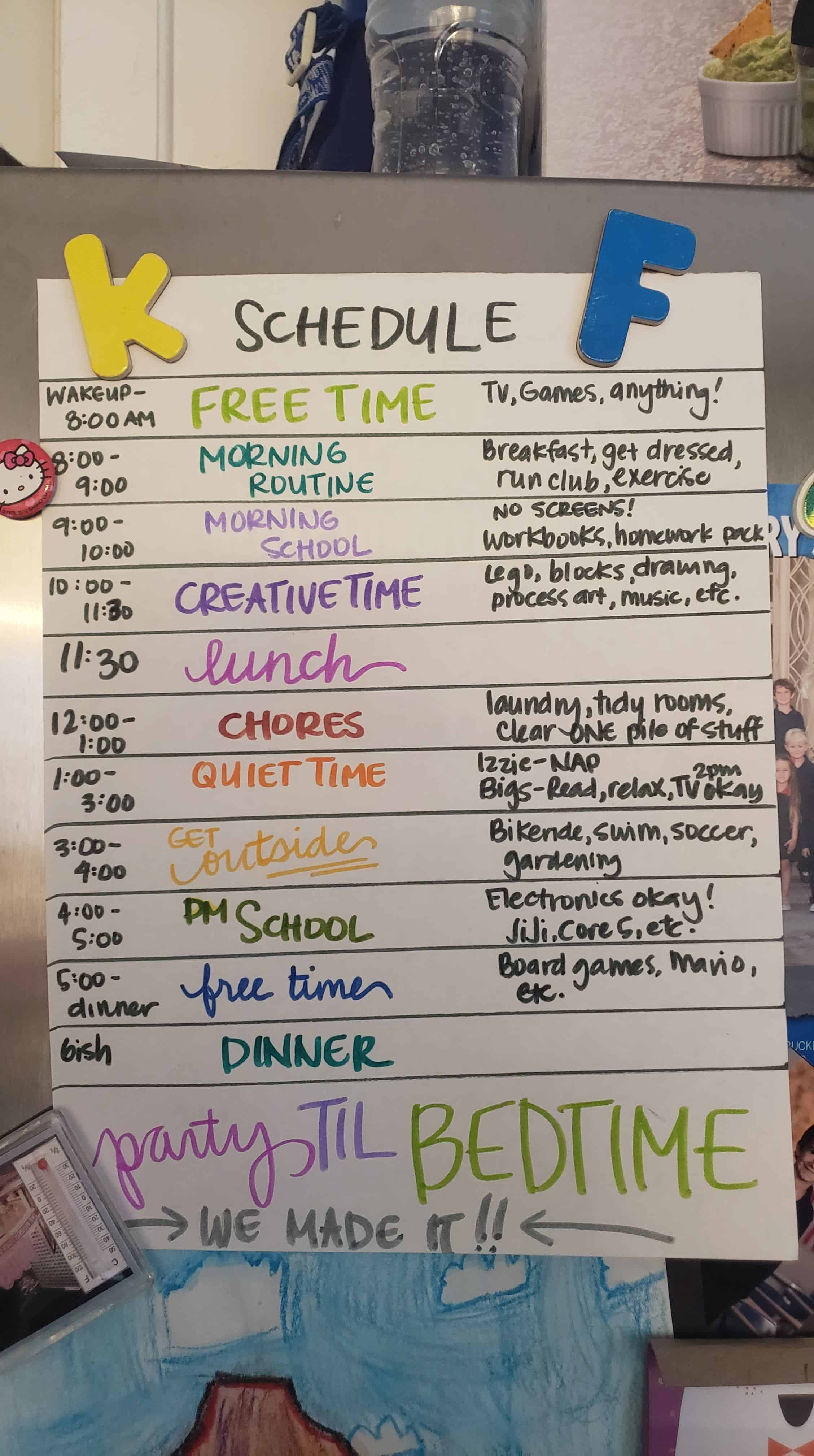 Written out daily schedule pinned to the fridge.