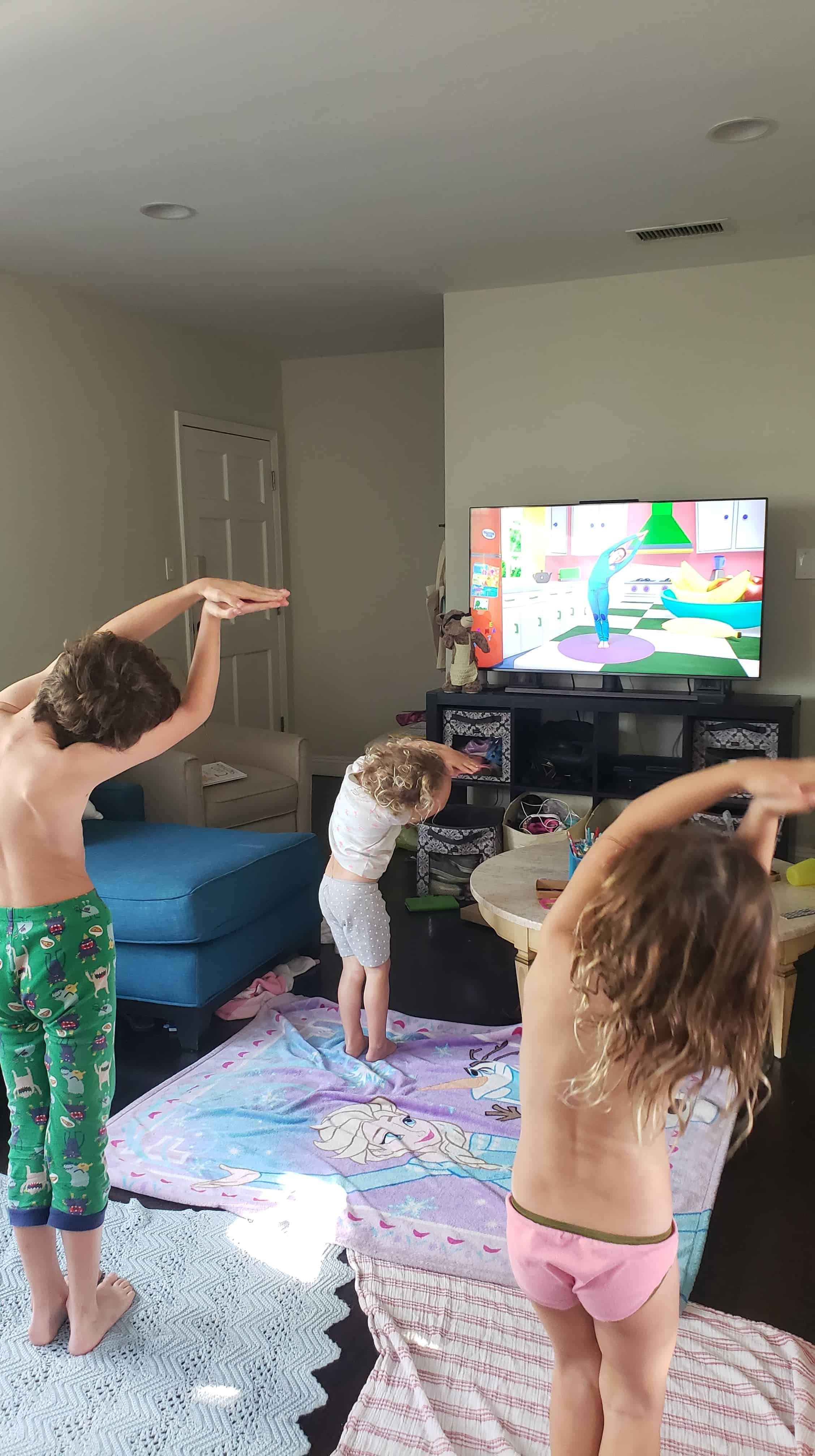 kids doing yoga to exercise during social distancing