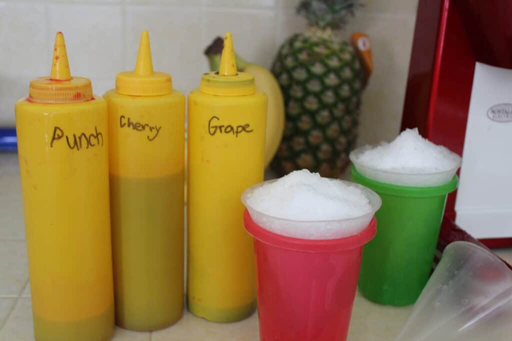 condiment bottles filled with homemade snow cone syrup