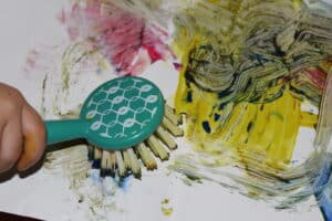 a messy painting by a preschooler, using a dish scrubber and paint