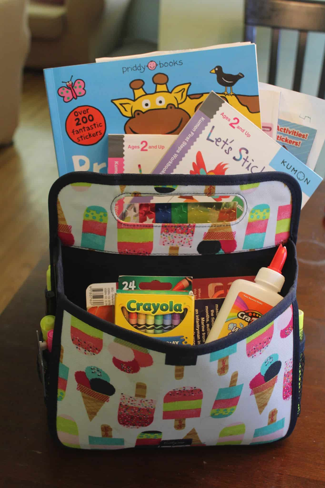 Double duty caddy pack from Thirty-one full of art and fun supplies to keep the kids busy