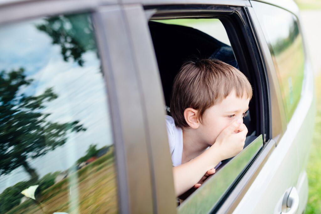 car sick kid with an open window