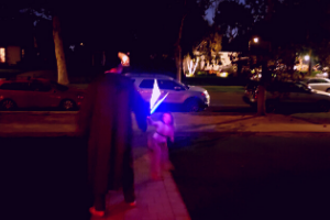 family playing with glow stick light sabers