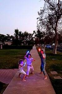 kids taking a walk with glow sticks