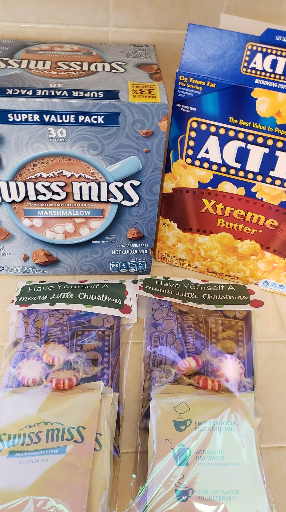 assembled christmas treat bags with popcorn and cocoa