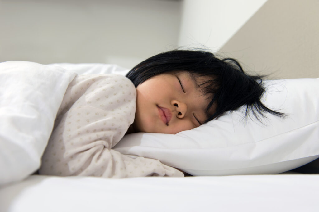 little girl sleeping on a pillow