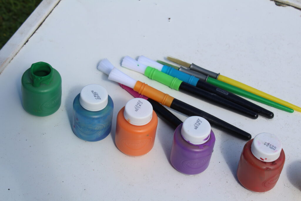 paints set up in ROYGBIV order
