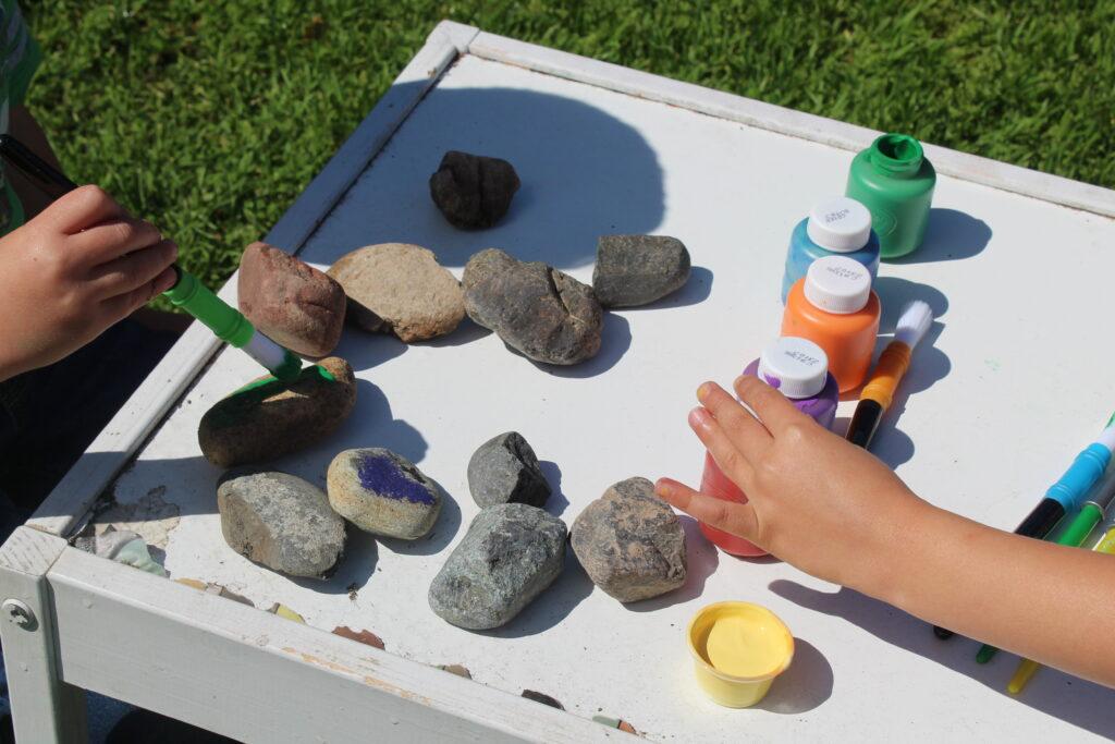 kids painting rocks rainbow colors