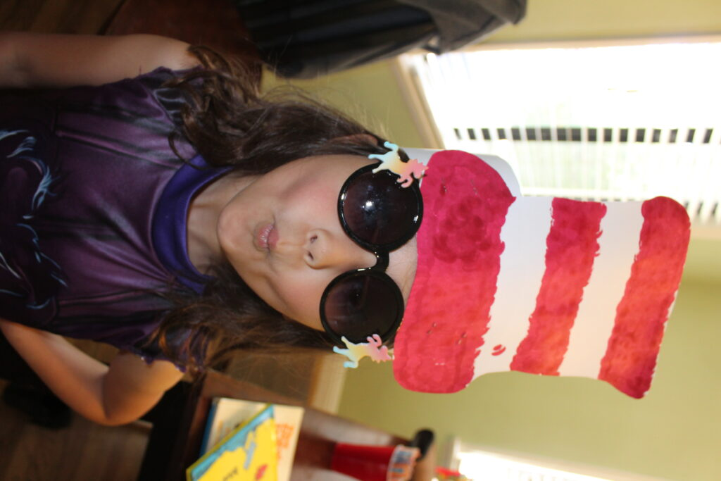 girl wearing home made cat in the hat hat