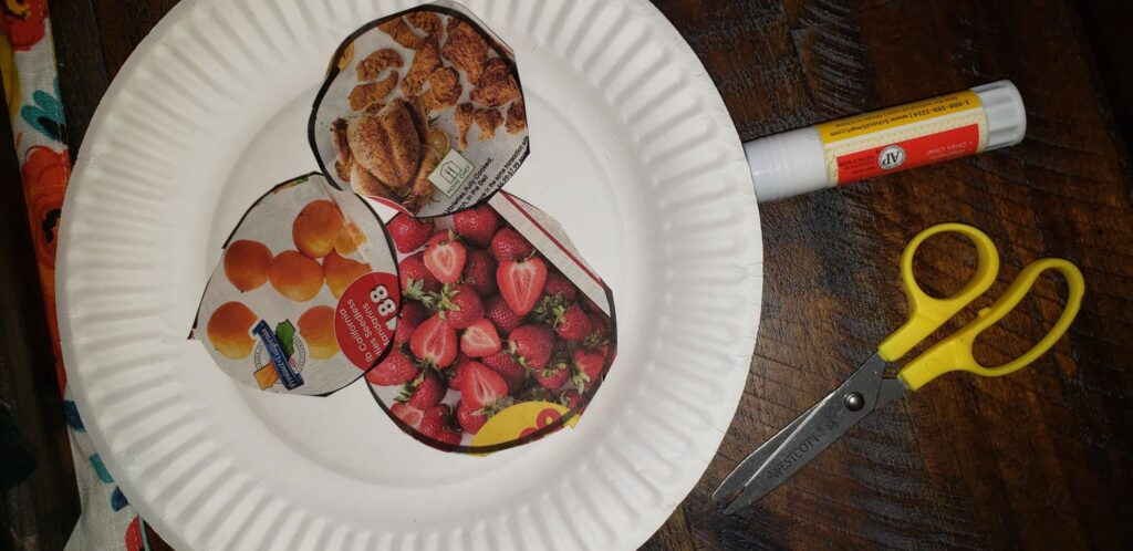 finished grocery ad craft on paper plate