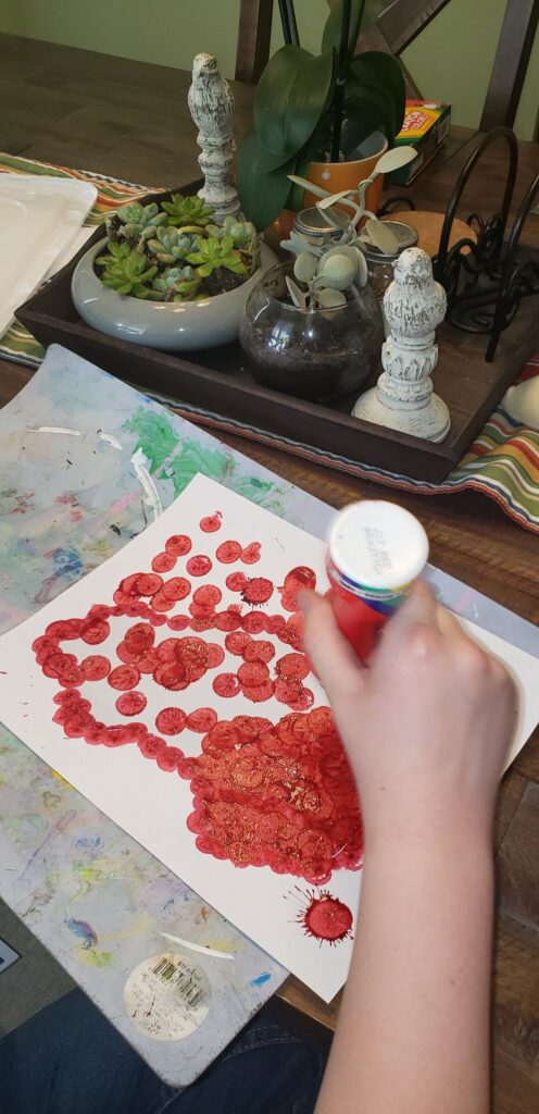 child using dot markers