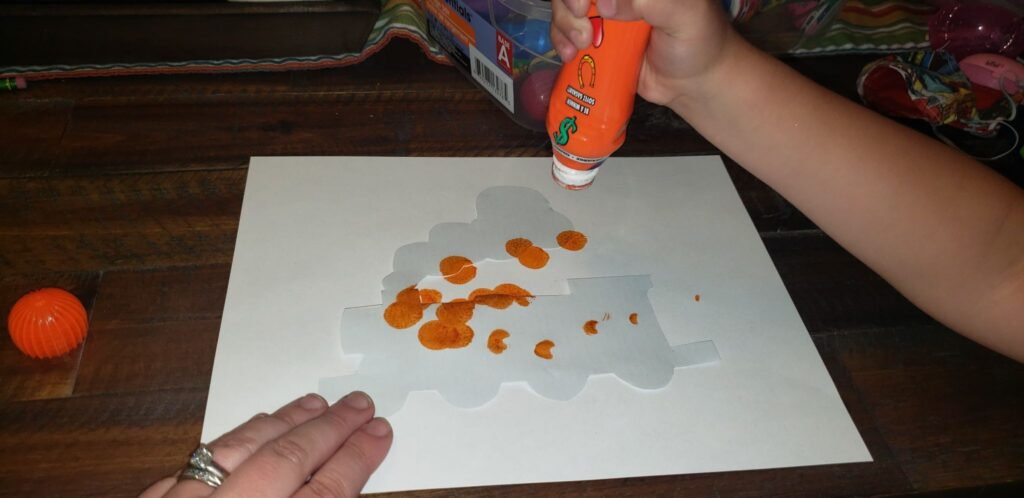 child using dot markers on template