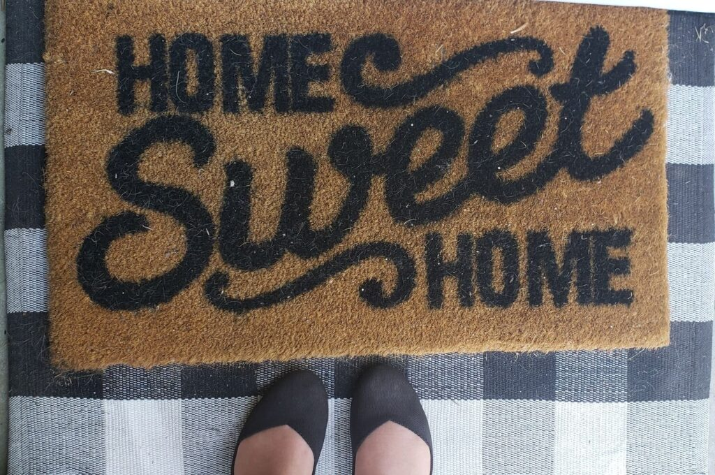"""rothys by a door mat that reads """"home sweet home"""""""