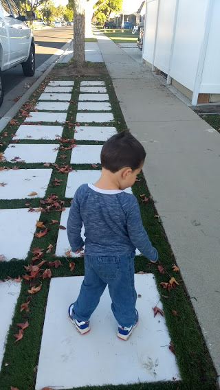 toddler hopping on stepping stones