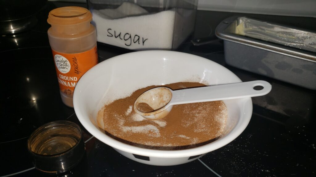 cinnamon and sugar mixed in a bowl