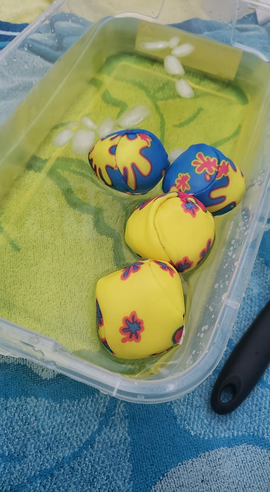 water balls in yellow water