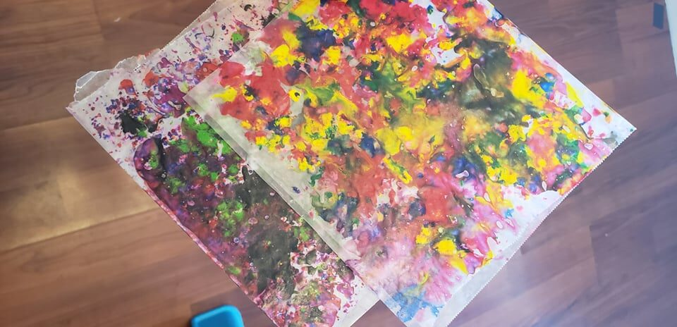 melted crayon shavings in wax paper