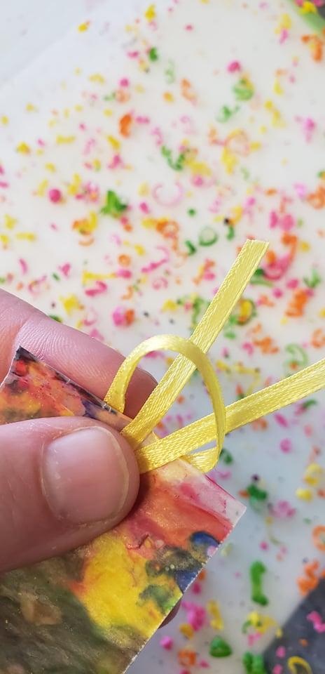 ribbon looped through top of bookmark