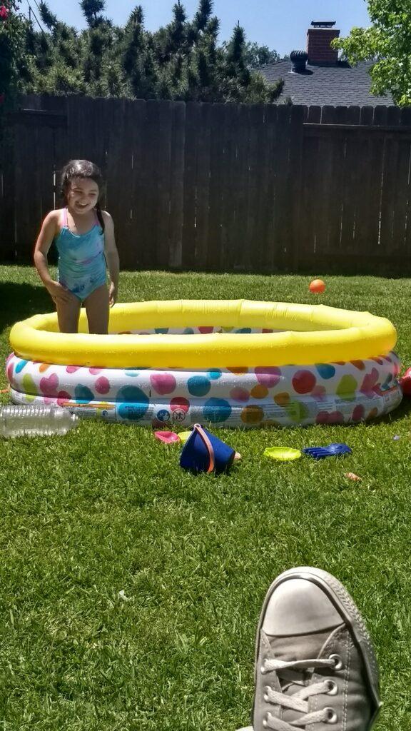 toddler in kiddie pool